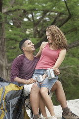 Young camping couple in a forest