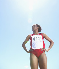 Low angle view of female track athlete