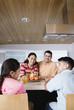Family gathered around kitchen counter