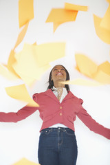 Woman throwing papers into air