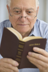 Senior man reading the Bible