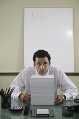 Office worker with stack of papers