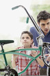 Boy with father looking at bike through store window