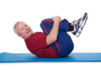 Portrait Of Senior Man Exercising