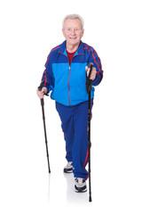 Senior Man Walking With Hiking Poles