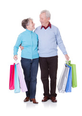 Senior Couple Holding Shopping Bags