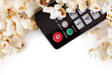 Close-up Of Remote Control And Popcorn