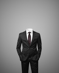 man without head on gray background