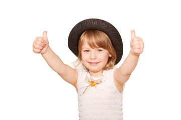 A little girl in a black hat showing thumbs up.