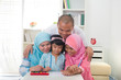 malaysian family doing homework together