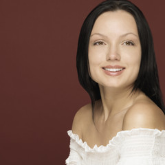 Studio shot of woman smiling
