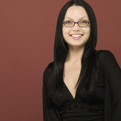 Studio shot of woman smiling and wearing eye glasses