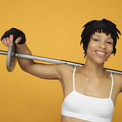 African woman lifting weights