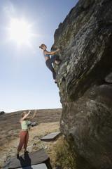 Two women rock climbing