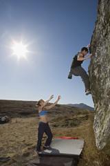 Couple rock climbing