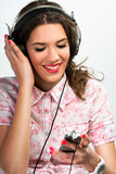 Woman listening to music over a phone