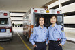 Portrait of Asian female paramedics in front of ambulance