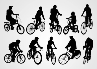 silhouette of people who were cycling