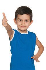 Little boy in blue holds his thumb up
