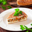 Slice of pie with chicken and vegetables , selective focus