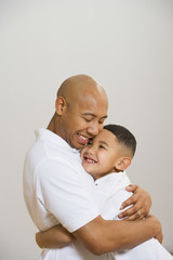 Portrait of Indian father and son hugging
