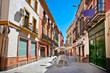 Street in old part of Seville town on summer day, Spain.