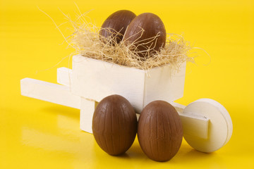 Four Easter eggs and pushcart