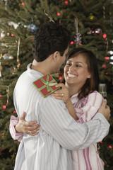Hispanic couple hugging on Christmas