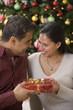 Hispanic couple exchanging gift