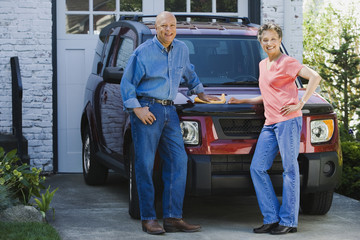 Senior African American couple polishing car