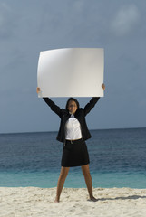 Hispanic businesswoman holding blank sign