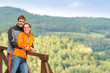 Loving couple on romantic summertime weekend hill