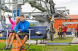 Happy couple traveling chair lift enjoying landscape