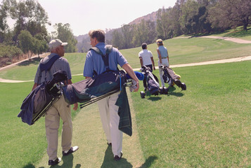 Multi-ethnic couples playing golf