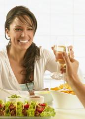 Hispanic woman toasting over food