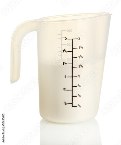 Measuring cup with flour isolated on white