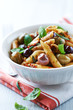 Penne with dried tomato pesto, olives and herbs