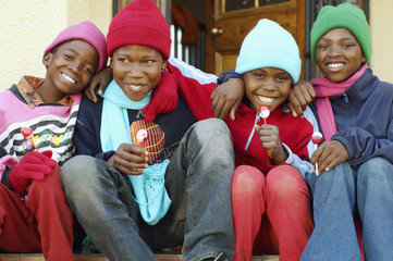 African children wearing winter hats