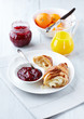 Croissant with raspberry marmalade on a plate