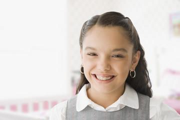 Hispanic girl with orthodontic braces