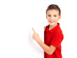 Portrait of  cheerful boy pointing on white banner