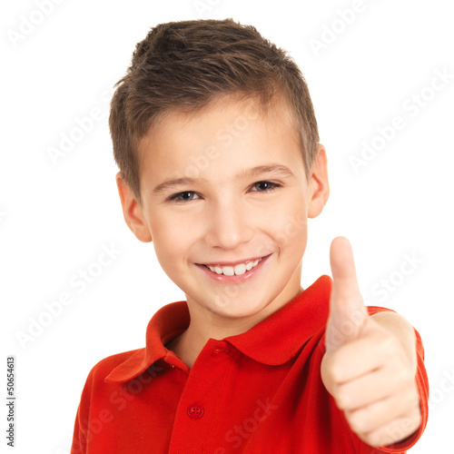 Happy boy showing thumbs up gesture