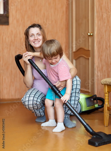 Family chores with vacuum cleaner