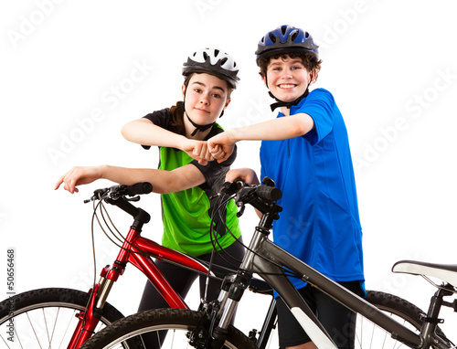 Cyckists - boy and girl isolated on white background