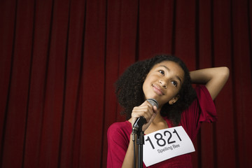 Mixed Race girl wearing number on stage