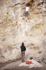 Argentinean men rock climbing together