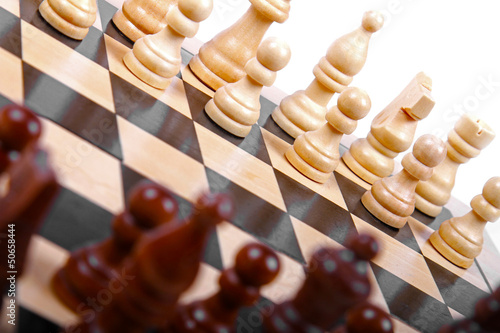 wooden chess pieces on the board