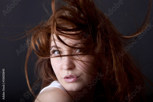 Foto op Canvas Kapsalon young beautiful woman and wild flying hair