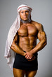 Muscular male wearing a Middle Eastern headdress