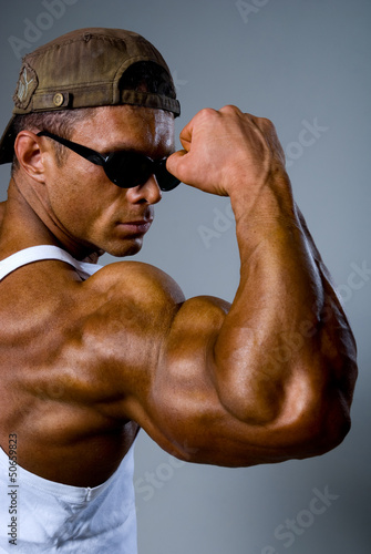 Athletic man showing his muscles